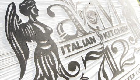 Andrew Michael Italian Kitchen sign