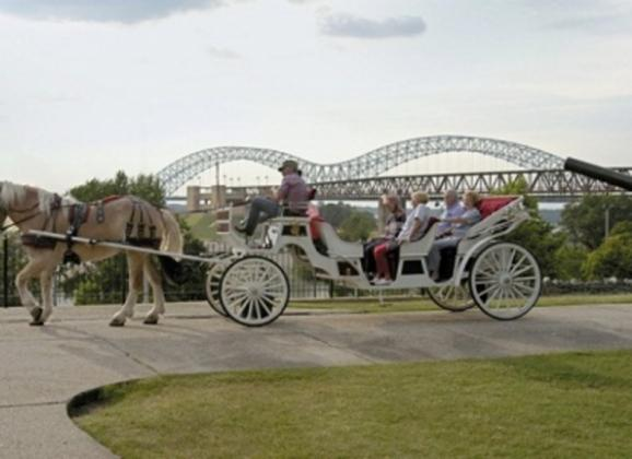 Spectacular views of the Mississippi River on a carriage ride in downtown Memphis. Photo by Baxter Buck